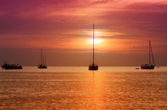 Sailboats at dusk. Tropical landscape Stock Photography