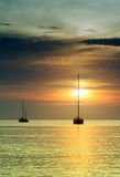 Sailboats at dusk. Tropical landscape Royalty Free Stock Photography