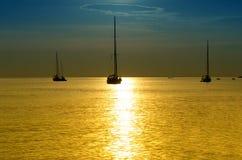 Sailboats at dusk. Tropical landscape Stock Photos