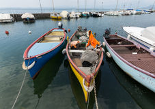 Sailboats and fishing boats in Lazise on The Garda Lake Stock Photos
