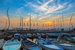 Sailboats fishing boats at Porto di Bardolino harbor on Garda La Royalty Free Stock Image