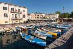 Sailboats and fishing boats at Porto di Bardolino harbor on The Garda Lake Royalty Free Stock Photos