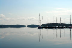 Sailboats floating in blue lake in summer. Stock Photo
