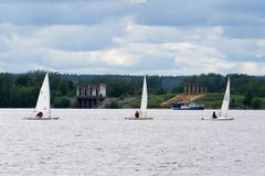 Sailboats floating on the water under a storm cloud Competition sport of sailing Stormy weather Summer travel. Stock Photo