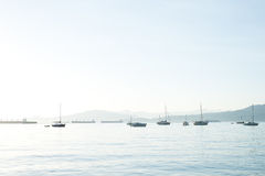 Sailboats and freight ships in Vancouver, BC, Canada Royalty Free Stock Photography