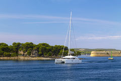 Sailboats in front of a fortress in Sibenik Stock Photography