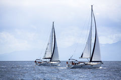 Sailboats in front of the regatta in the morning mist. Stock Photo