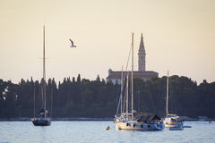 Sailboats in front of Saint Eufemia church Stock Photography