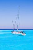 Sailboats full of tourists anchored at Navagio beach, Zakynthos island - July 13, 2015 Royalty Free Stock Photo