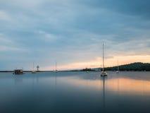 Sailboats On Grand Marais Harbor At Sunset 1. These are sailboats on the harbor during sunset. This is in Grand Marais. This is in the Lake Superior North Shore Stock Image