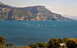 Sailboats in the Gulf of Saint Hospice off the Coast of Cap Ferrat. Sailboats sailing in the protected waters of the Gulf of Saint Hospice near Cap Ferrat on the Royalty Free Stock Photo