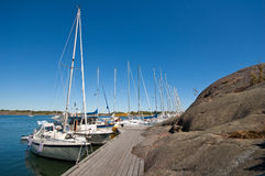 Sailboats in harbor. Sailboats anchored at harbour on small island Stock Photos