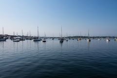 Sailboats on a Harbor on a Clear Sunny Day Stock Image