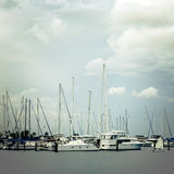 Sailboats in Harbor on Cloudy Day. Sailboats sit in the harbor on a cloudy day in St. Petersburg, Florida Stock Photos