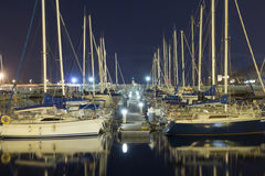 Sailboats in the harbor at night Royalty Free Stock Photos