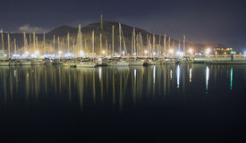 Sailboats in the harbor at night Royalty Free Stock Images