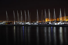 Sailboats in the harbor at night Stock Photos