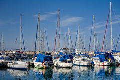 Sailboats. Harbor in Tel Aviv, Israel with sailboats leading out to the Mediterranean Sea Royalty Free Stock Photos