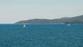 A sailboats on the horizon in the beautiful Adriatic sea stock footage