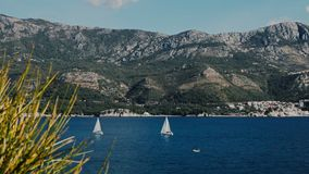 A sailboats on the horizon in the beautiful Adriatic sea stock video