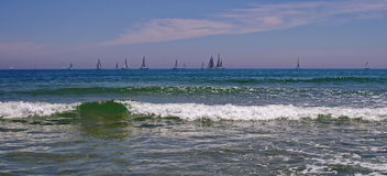 Seascape. Summer, sea, sun, beach, holiday, fun. Sailboats on the horizon - Black Sea, landmark attraction in Romania Royalty Free Stock Photo