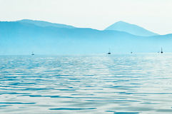 Sailboats in Ionian sea. Sailboats in the Ionian Sea in Greece Royalty Free Stock Photo