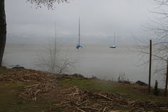 Sailboats on lake during storm royalty free stock images