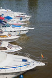 Sailboats lined up in a line Stock Photos