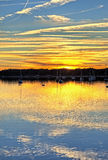 Sailboats lined up at sunset hdr Royalty Free Stock Images