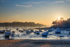 Sailboats at low tide and sunset on the beach of St Briac near St Malo, Brittany, France Stock Photography