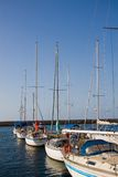 Sailboats at marina dock. Several fancy sailboats and yachts tied to a dock in Chania, Crete, Greece stock photos