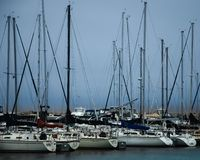 Sailboats in a marina with a storm rolling in on Lake Michigan. Sailboats docked at a marina in Kenosha Wisconsin on Lake Michigan with a storm rolling in royalty free stock photo