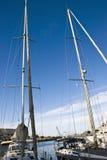 Sailboats masts. Beautiful   sailboats moored to wharf at the harbor Stock Image