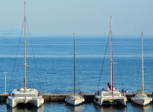 Sailboats, Mediterranean Sea, Corfu, Greece. Sailboats docked at a marina in the  Mediterranean Sea in Corfu, Greece Stock Photos