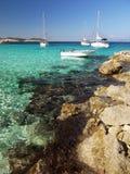 Sailboats moored at coast island Royalty Free Stock Photo