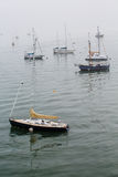 Sailboats Moored in Foggy Harbor Royalty Free Stock Photography