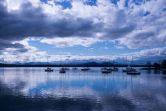 Sailboats moored on Lake Champlain in the calm before the storm Royalty Free Stock Photography