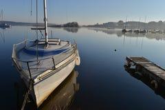 Sailboats Moored on lake Stock Photography