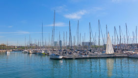Sailboats moored in the port of barcelona, near the Ramblas and Royalty Free Stock Photo