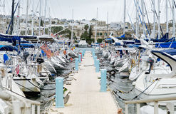 Sailboats moored in a row on docks at Manoel Island Marina stock photos