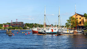 Sailboats moored on the shore of the Skeppsholmen Royalty Free Stock Images