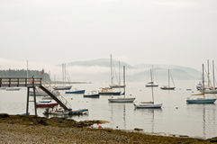Sailboats in morning fog Royalty Free Stock Photography