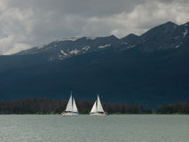Sailboats on Mountain Lake Stock Images