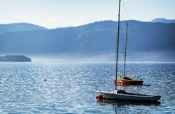 Sailboats and mountains Stock Images