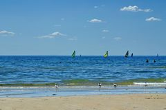 Sailboats off the beach in Frankston. Sailboats racing just the beach in front of the Pacific Ocean in Frankston, Australia Stock Photography