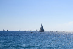 Sailboats off the coast of Cannes Royalty Free Stock Photography