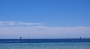 Sailboats on the open ocean Royalty Free Stock Photos