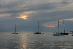 Sailboats on open sea in a summer at sunset time Royalty Free Stock Image