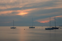 Sailboats on open sea in a summer at sunset time Stock Photo