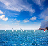 Sailboats Optimist learning to sail in Mediterranean at Denia royalty free stock images